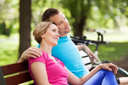 Couple on park bench photo