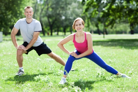 man working out: Couple Exercising In Park