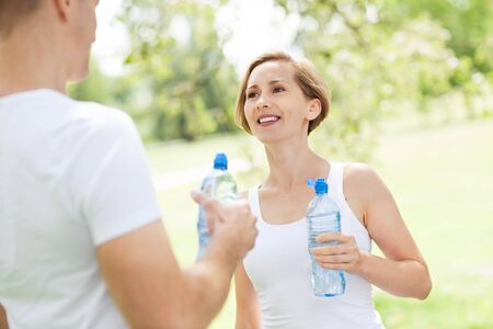 Couple drinking water after exercise Stock Photo - 14775244