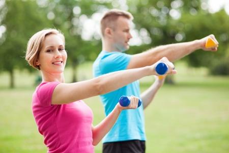 Couple exercising with dumbbells photo
