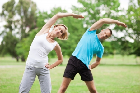 man working out: Couple working out in park