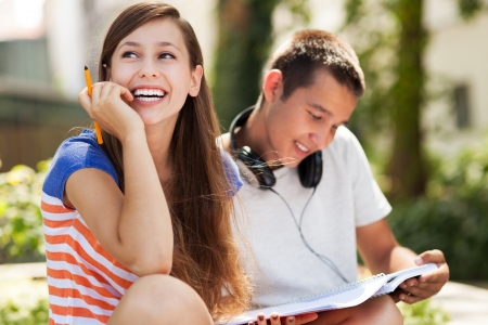 toothy smile: Happy students Stock Photo