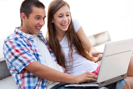 Couple looking at laptop together photo