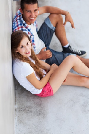 Teenage couple sitting photo