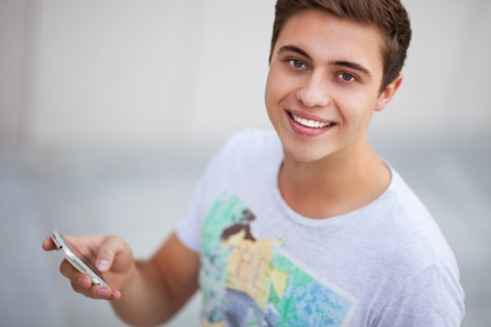 teenage boy: Casual guy with mobile phone Stock Photo