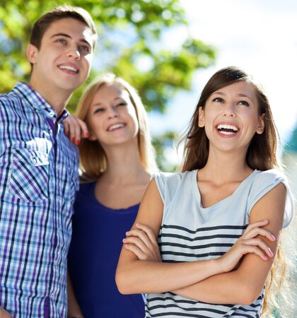 teenagers laughing: Three young people smiling Stock Photo