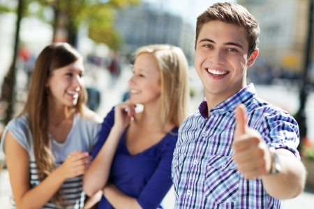 youth group: Young man showing thumbs up