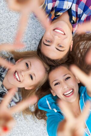 Friends showing peace sign Stock Photo - 15339597