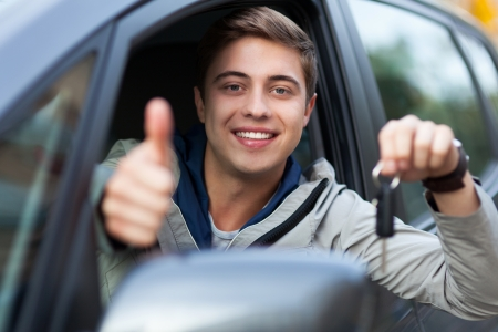 Young man doing thumps-up in car Stock Photo - 15552140