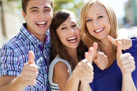 youth group: Young people with thumbs up Stock Photo