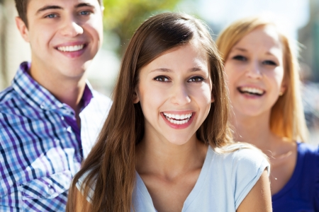 three friends: Three young people smiling Stock Photo