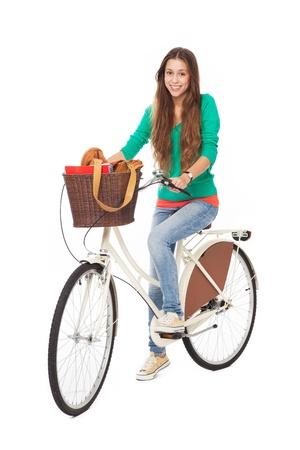 mujer cuerpo completo: Mujer en una bicicleta Foto de archivo