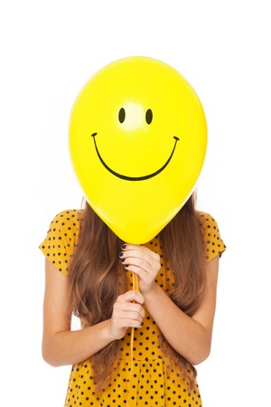 obscured face: Woman with smiley face balloon