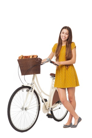 Woman standing with bike photo