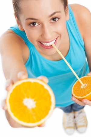 Woman drinking orange juice photo