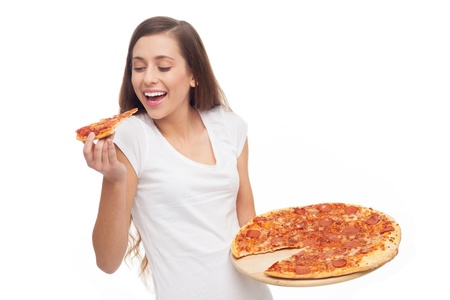 eating pizza: Woman eating pizza