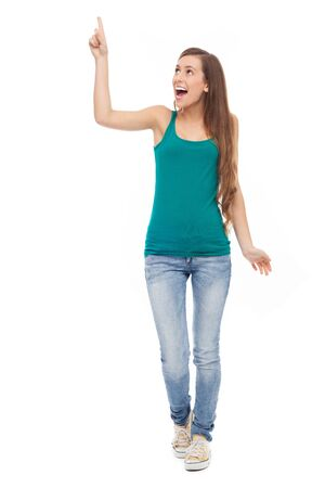 woman pointing up: Young woman pointing up