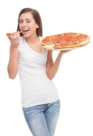 eating: Jeune femme mangeant de la pizza Banque d'images