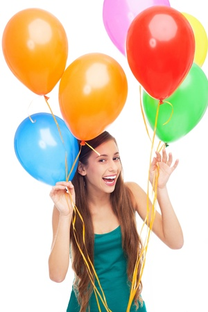Happy woman holding balloons photo