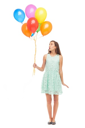 Woman holding a bunch of balloons Stock Photo
