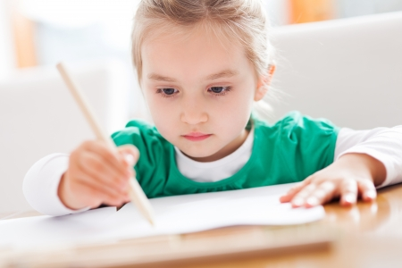 kids writing: Little girl drawing