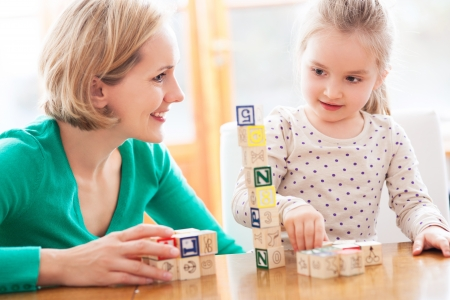 Mother and daughter playing with blocks photo
