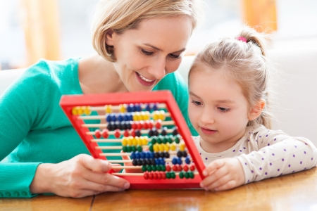 counting: Mother and daughter with abacus