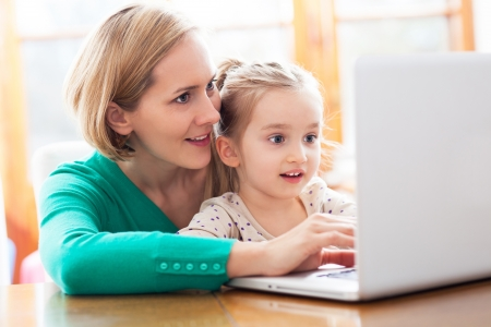 family day: Daughter and mother looking at a laptop