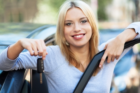 Woman showing car key Stock Photo - 16303416