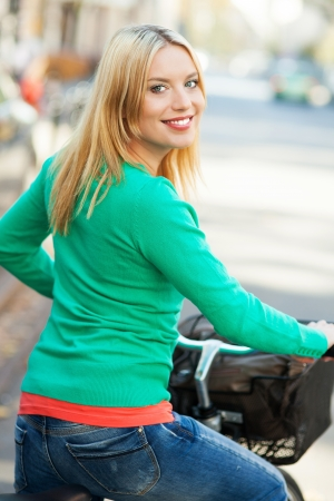 Young woman on bike Stock Photo - 16305656