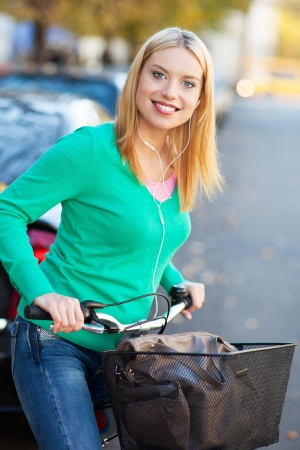 Woman riding a bike in the city Stock Photo - 16305386