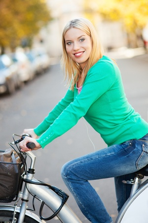 Portrait of woman with bike Stock Photo - 16305389