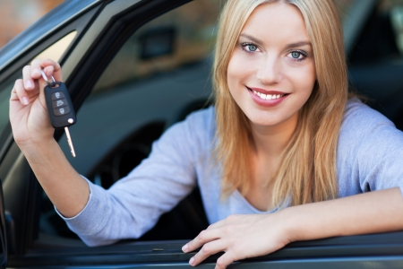 car keys: Woman Showing off New Car Keys Stock Photo