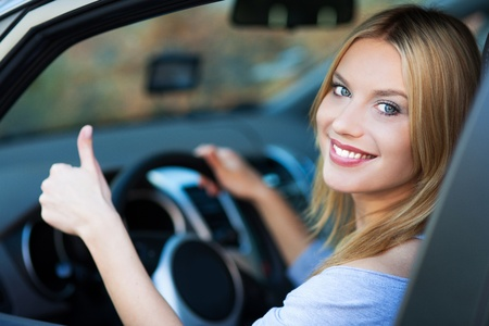 Woman in car giving thumbs up Stock Photo - 16335906