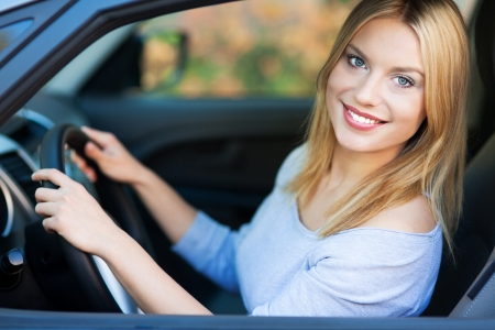 Smiling young woman sitting in car Stock Photo - 16335907