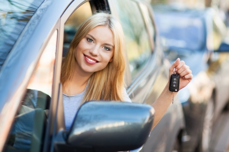 Young woman showing car key Stock Photo - 16366731