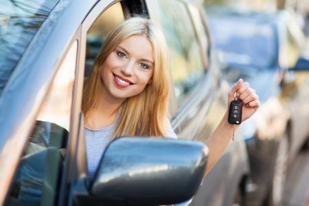 Young woman showing car key Stock Photo - 16366731