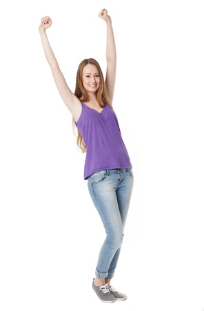 clenching fists: Young woman with arms raised