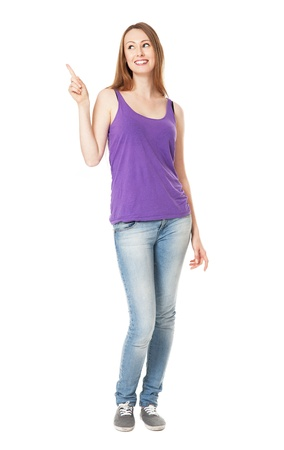Female teenager pointing up Stock Photo