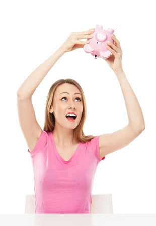 Woman checking piggy bank for money photo