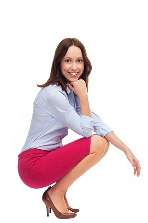 Businesswoman crouching  photo