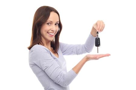 car keys: Young woman showing car key