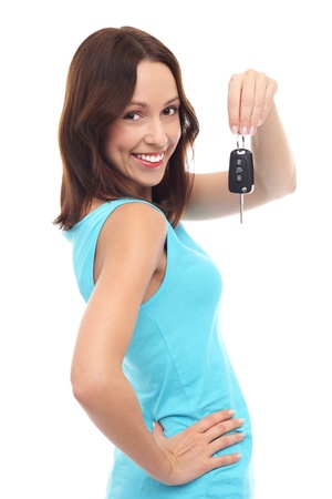 car keys: Smiling woman holding car key
