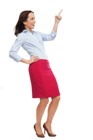 Business woman pointing up photo