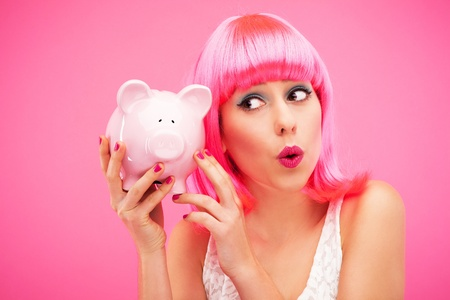 hairpiece: Woman checking her piggy bank