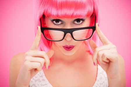Attractive woman peeking over glasses Stock Photo - 16858319