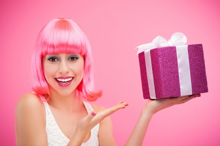 make a gift: Happy woman holding gift
