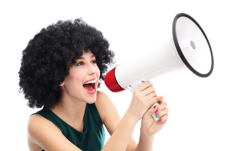 Woman shouting through megaphone photo