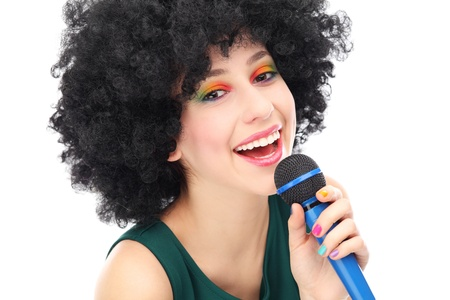 Woman with afro holding microphone photo