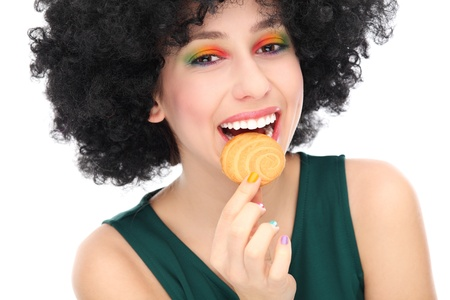 70s adult: Woman eating cookie Stock Photo